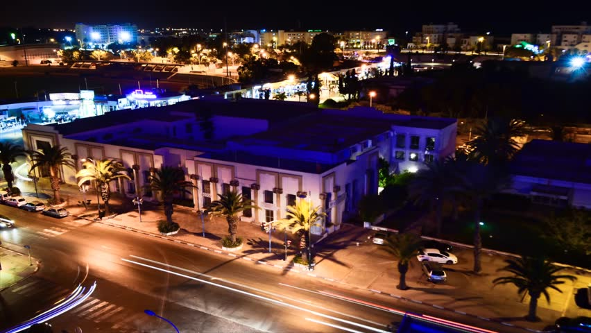 AGADIR, MOROCCO - CIRCA 2012: Time lapse of Agadir city centre at night circa July 2012 in Agadir, Morocco. Camera pan.