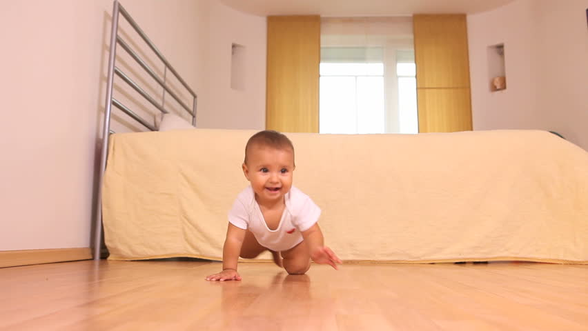 Adorable little baby crawling on the floor