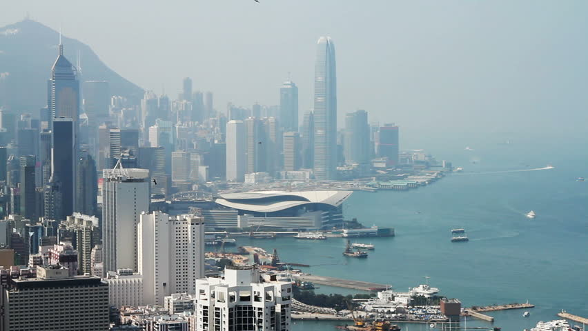 Hong Kong island skyline and pair of eagles flying over the city. | Shutterstock HD Video #2764640