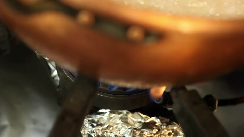 making caramel, sugar boiling: still white