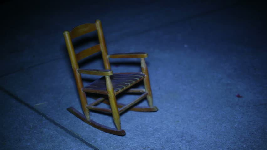 Ghost moving a rocking chair poltergeist stock footage
