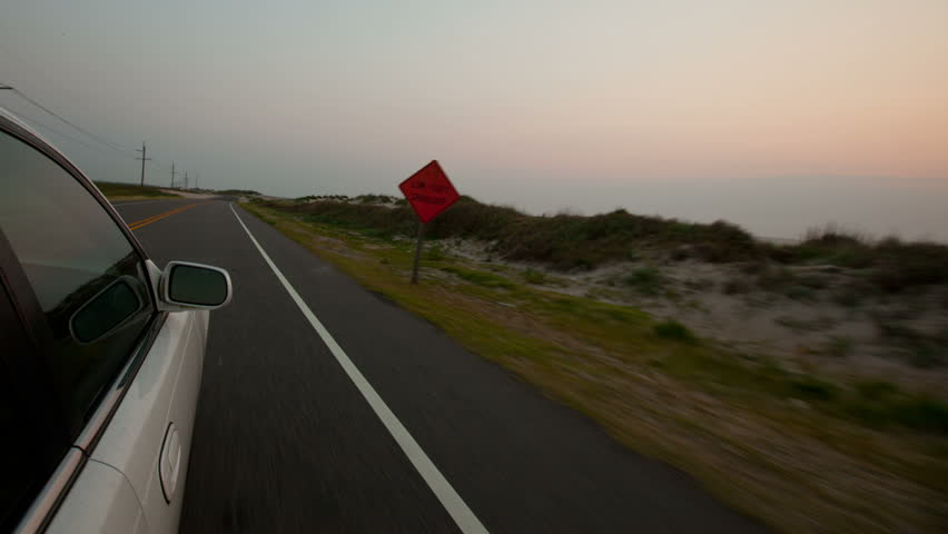 Outer Banks Driving External Vehicle Car Time-lapse video at Sunrise