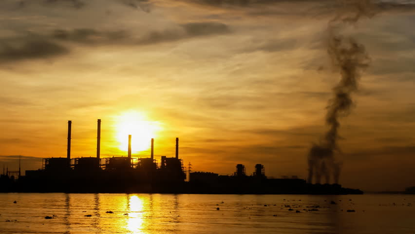 Electric power station at sunrise, time lapse - HD stock footage clip