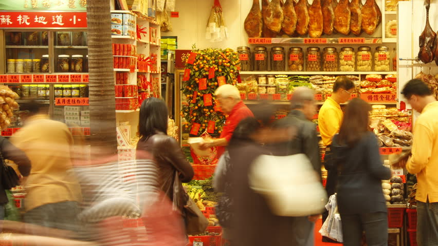 HONG KONG - FEBRUARY 8: Time lapse of people walking through Chinese food store