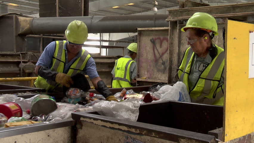 ORLANDO, FLORIDA - CIRCA   2009: Workers in an assembly line sorting trash - HD stock footage clip