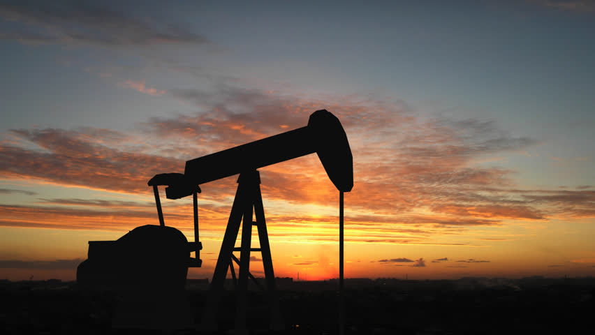 Oil pump over sunrise - HD stock footage clip