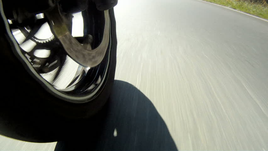 Motorcycle Wheel Close-up racing on the highway - HD stock video clip