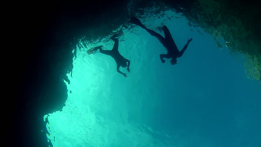 Father and daughter diving