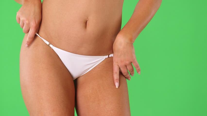 Woman's torso with white bikini underwear and hands