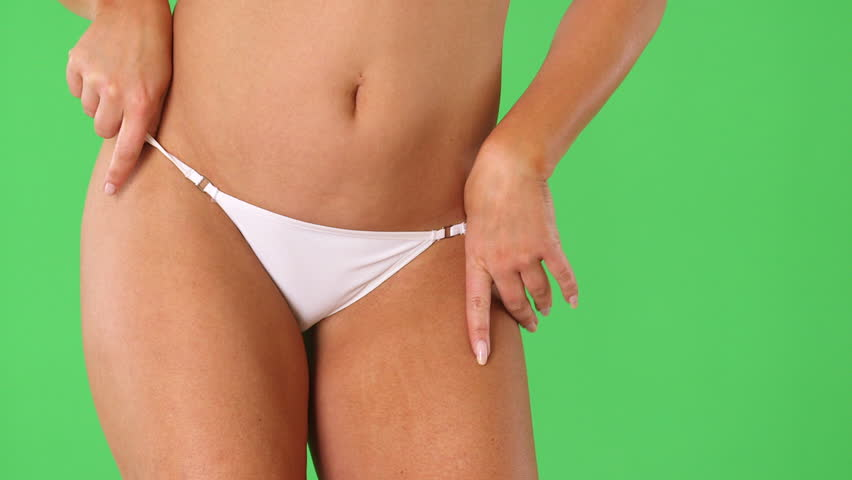 Woman's torso with white bikini underwear and hands