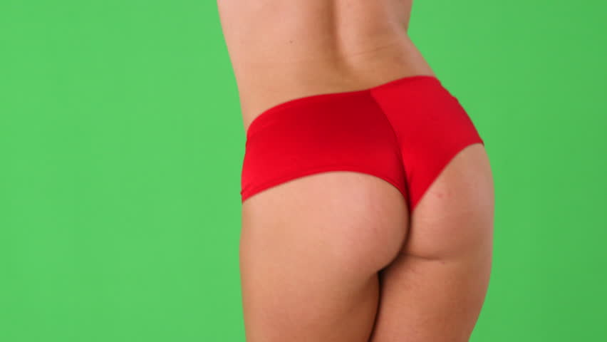 Closeup of sexy woman's behind in red panties