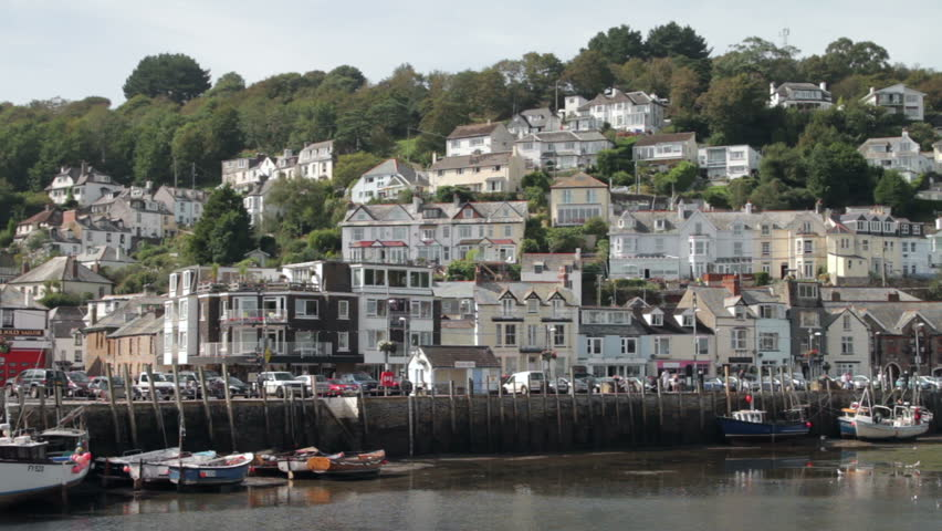 Harbour and quay wall with houses on the hillside, Looe, Cornwall