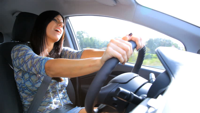 Woman Flossing Teeth While Driving Car