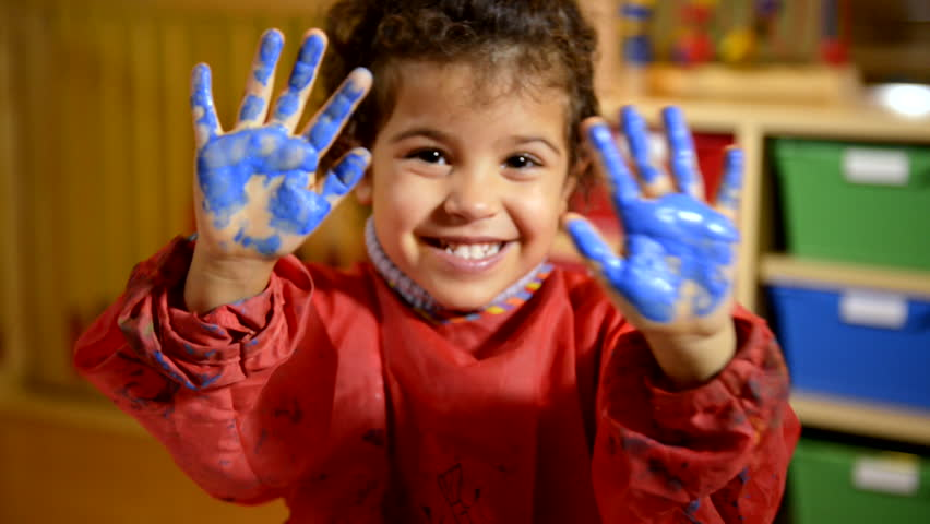 Happy children having fun and painting with hands in kindergarten. Sequence