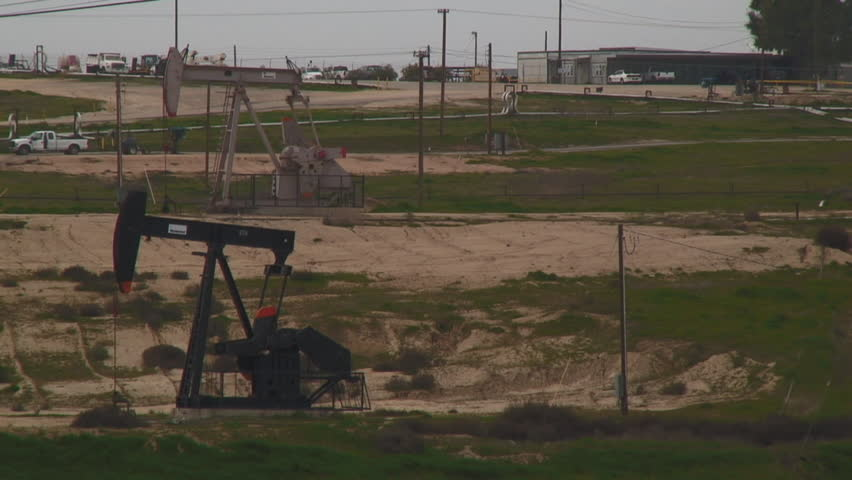 Oil Well With The Pump Jack In Action - HD stock footage clip