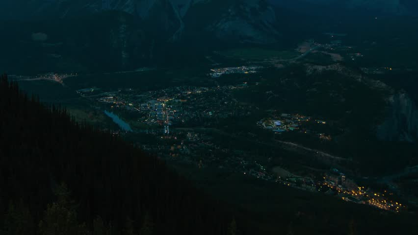 Overlooking the city of Banff, Alberta,Canada. Time lapse of city lights and traffic keep moving in the city of Banff