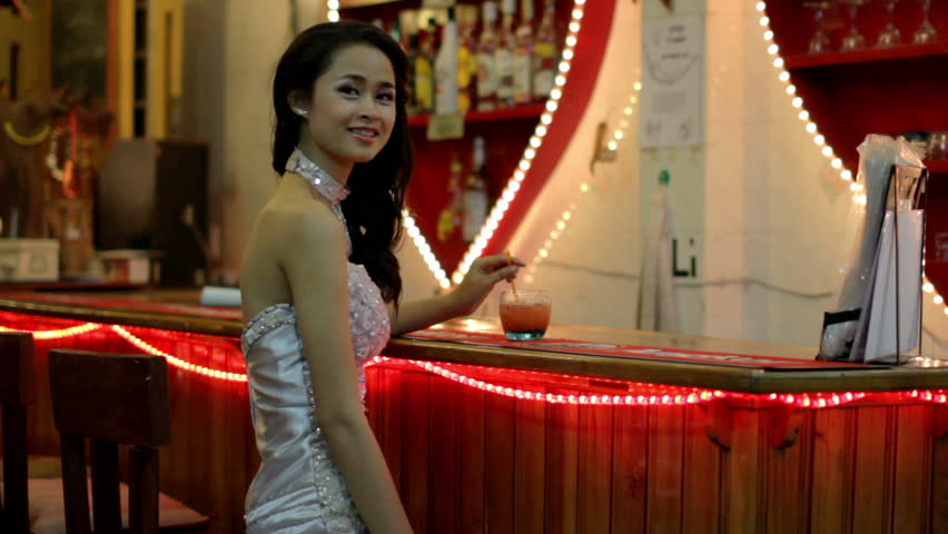 gorgeous Asian woman alone at a bar - HD stock footage clip