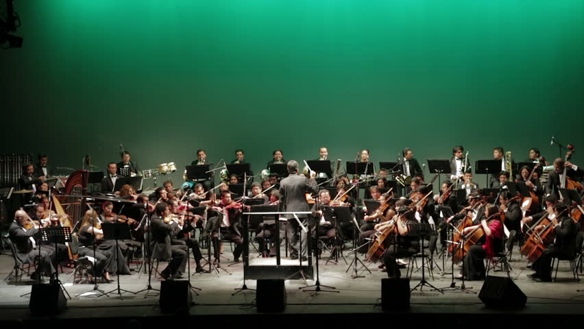 GUANAJUATO, MEXICO - CIRCA OCTOBER 2012: The Puebla symphonic orchestra playing on stage during the Cervantino festival circa October 2012 in Guanajuato, Mexico.