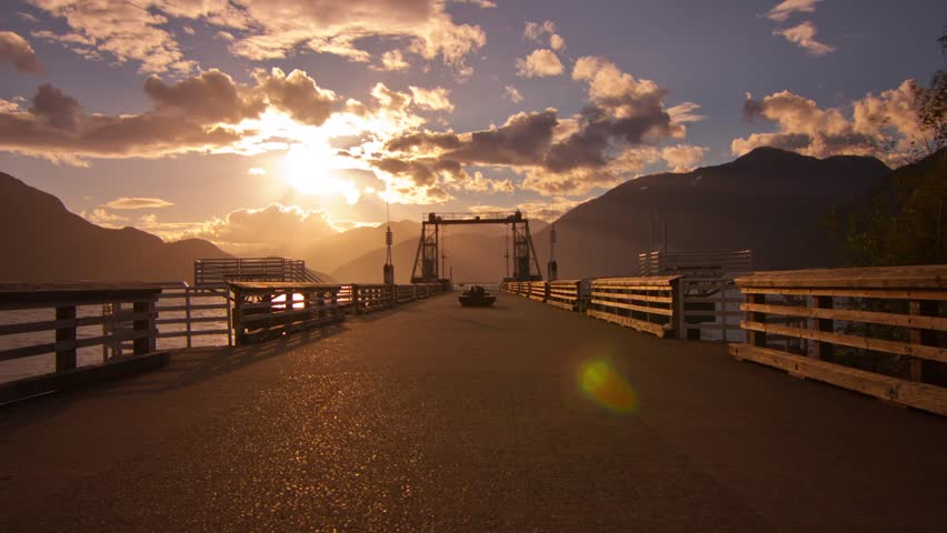 The Dock of Porteau Cove, BC, Canada. Shot on a Cloudy and Sunny Afternoon, Sun beaming through the Clouds Time Lapse. Shot in 4k RAW photo sequence