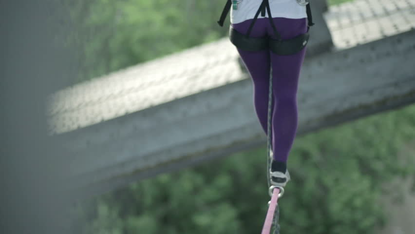 Girl goes on a tightrope high