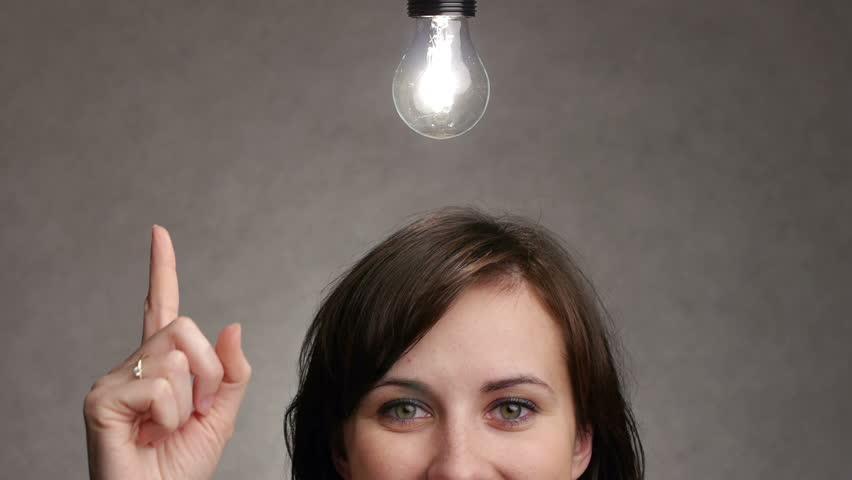 bulb lights up over a woman head when she gets an idea