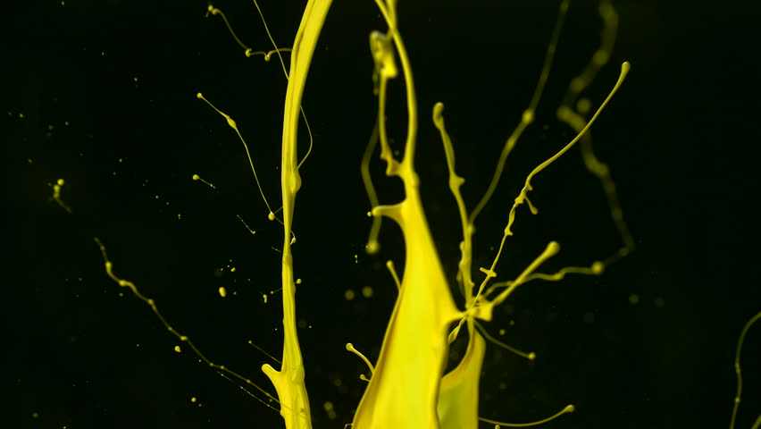 Yellow paint splash in the air shooting with high speed camera, phantom flex.