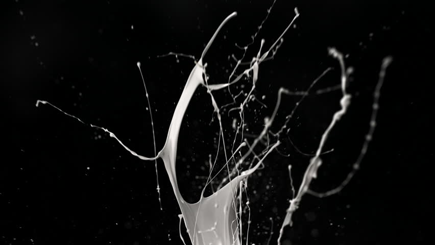 White paint splash in the air shooting with high speed camera, phantom flex.