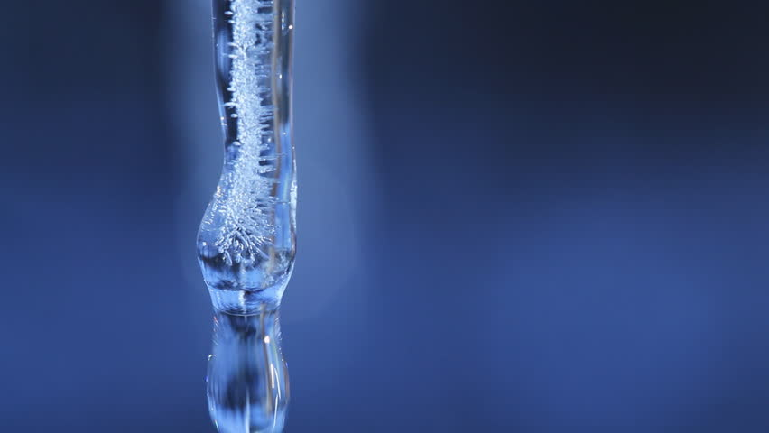 Extreme Macro Close Up Of A Single Icicle Melting And Dripping Water  - HD stock video clip