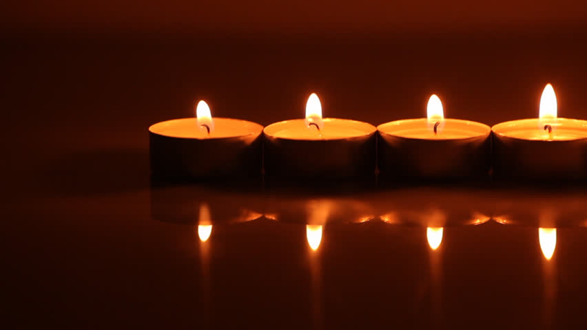 Row of burning candles