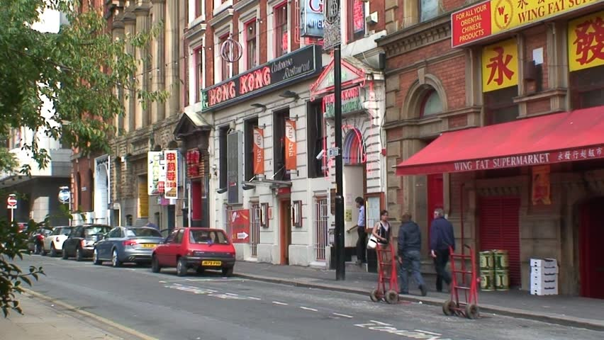 MANCHESTER, ENGLAND - CIRCA 2011: China Town shops and restaurants on Faulkner Street in Manchester.