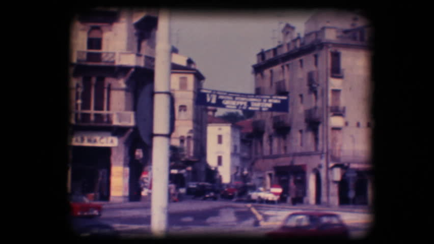 Vintage 8mm. Original footage digitalized. Busy street and statue in Padova, Italy