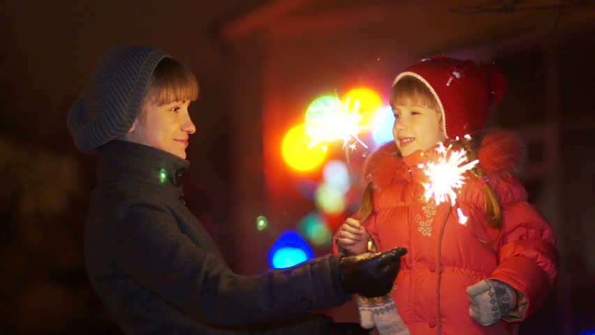 Mother and daughter with sparklers at night - HD stock video clip