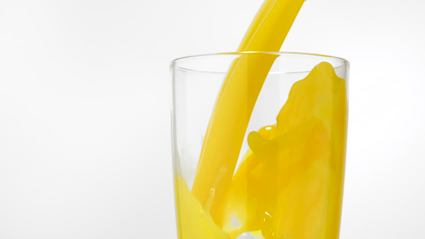 Pouring orange juice into glass shooting with high speed camera, phantom flex.