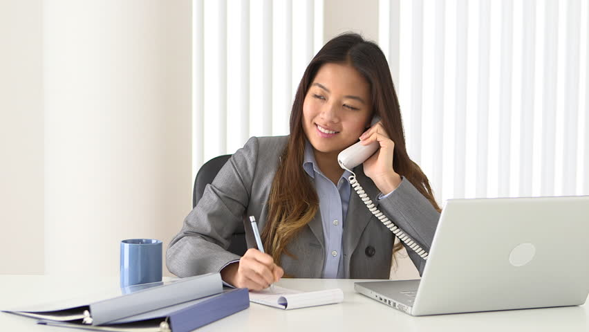 Asian businesswoman talking on phone while working at desk stock footage video 3258187 - Pics of girls bedrooms working desk years and over ...