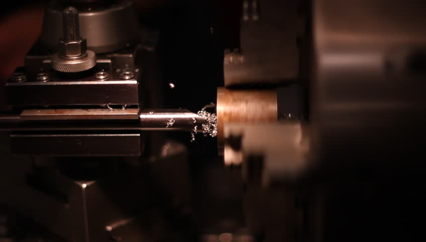Machining metal rod with metal lathe - HD stock footage clip