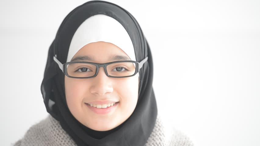 Cute teenager arabic girl wearing glasses smiling - HD stock video clip