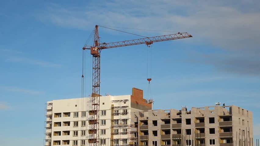 Lifting construction crane. construction site  - HD stock video clip