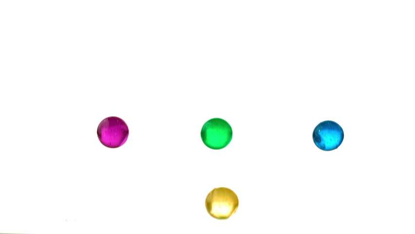 Four marbles falling and bouncing in slow motion | Shutterstock HD Video #3352997
