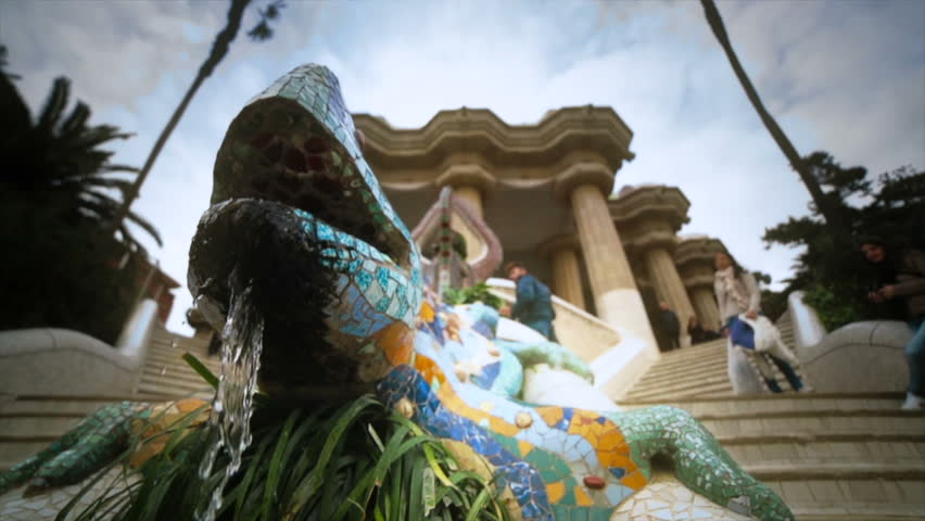 SPAIN, BARCELONA - CIRCA JANUARY 2013 Fountain of a salamander made of colorful mosaics in the Parc Gell.