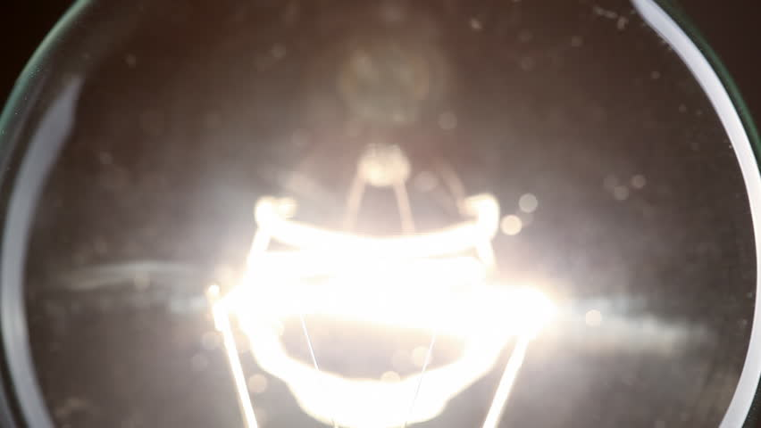 Light bulb on black background   Shutterstock HD Video #3371105