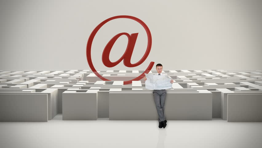Businessman with Map trying to find his way in a Maze with Internet Mail Sign,