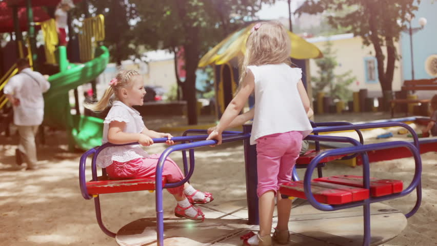 Three happy girls on the playground - HD stock footage clip