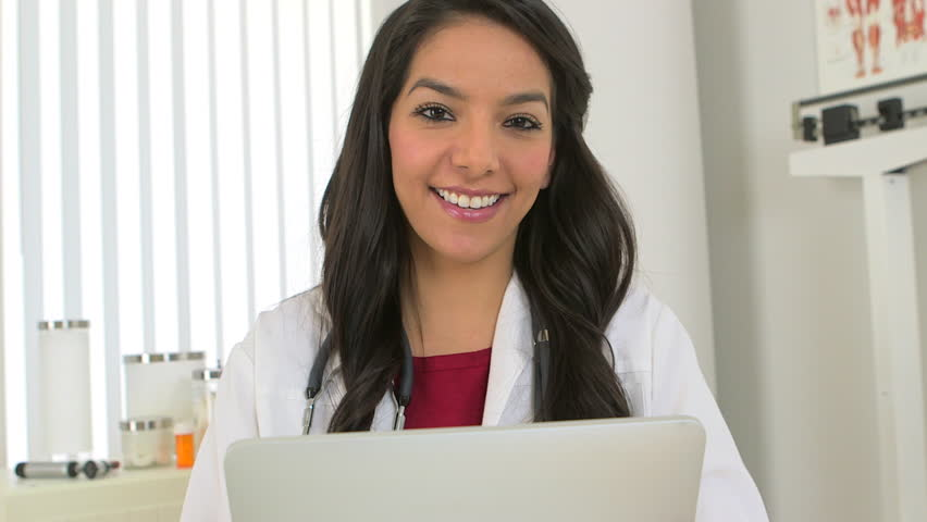 Young Hispanic doctor working on tablet | Shutterstock HD Video #3389501