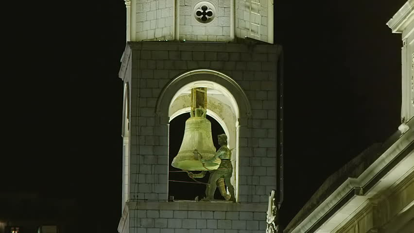 "Famous Dubrovnik old city tower with clock. Two bronze statues ""Maro"" and ""Baro"" strike the bell. - HD stock video clip"