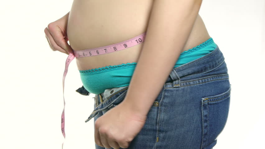 Overweight Female Measuring Waist Pink Measuring Tape.  Hands Sample Belly Fat.