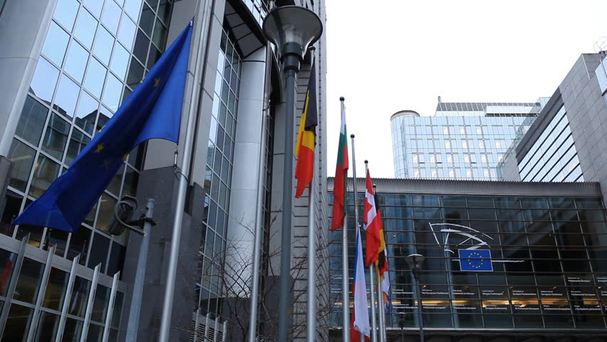 BRUSSELS, BELGIUM - DECEMBER 20: Flags in front of European Parliament Building in Brussels, Belgium on December 20, 2011. - HD stock video clip