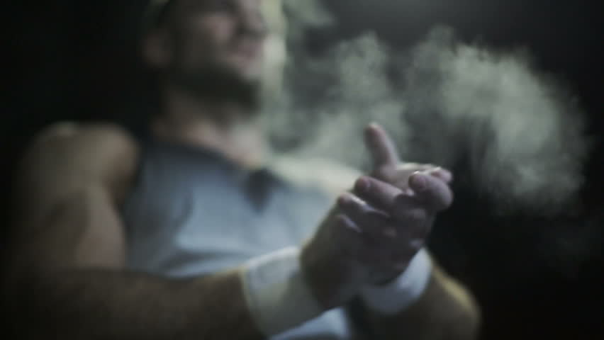 Muscular man prepares to lift heavy barbells - HD stock video clip