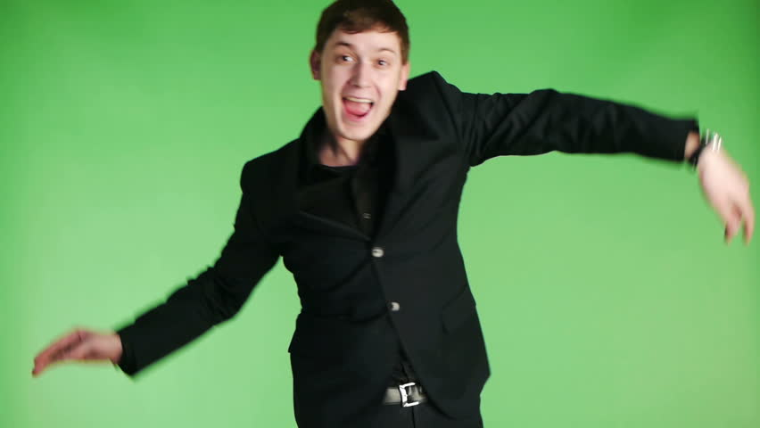 young happy businessman dancing at studio