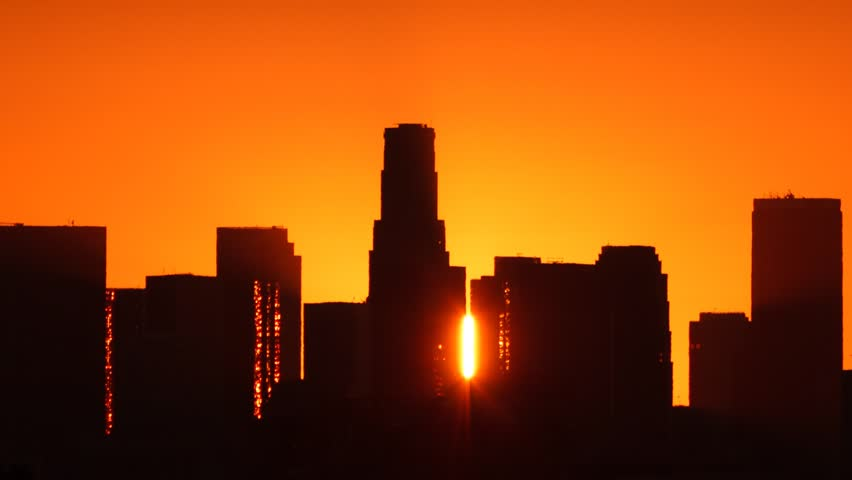 Los Angeles skyline sunrise. Pan and zoom out. Timelapse. Silhouette with Flare.  - HD stock video clip