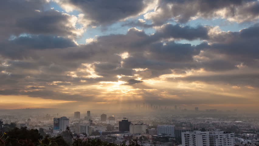 Sunrise over Los Angeles cityscape. Zoom in on downtown. Timelapse. - HD stock video clip